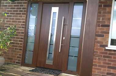 front entrance garage door with thin glass window